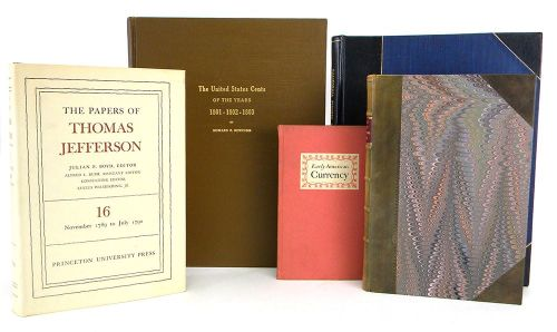 Image of books and catalogs depicting potemtial auction items